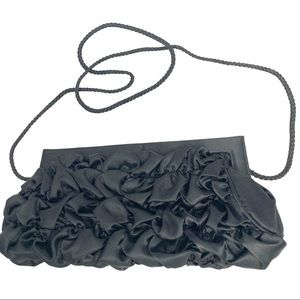 Black ruffled clutch with shoulder strap
